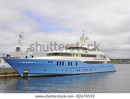blue and white Luxury Yacht anchored in Halifax Harbour, Nova Scotia Canada - stock photo
