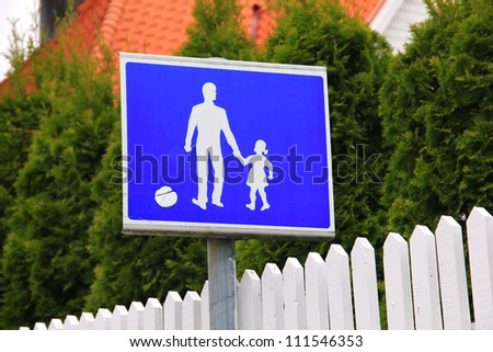 Blue and white parent and child road safety sign - stock photo