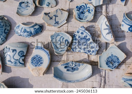 Blue and white porcelain pieces, pieces of antique porcelain is very expensive. - stock photo