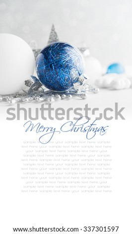 Blue and white xmas ornaments on glitter holiday background. Merry christmas card. Winter theme. Happy New Year. Space for text. - stock photo