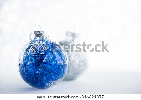 Blue and white xmas ornaments on glitter holiday background. Winter holidays. Xmas theme. - stock photo