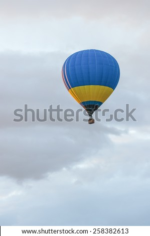 Blue and yellow Hot Air Balloons in Flight. Outdoor, Colorful / Colorful hot air balloon in blue sky. Blue and yellow aerostat - stock photo