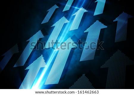 Blue arrows on black background - stock photo