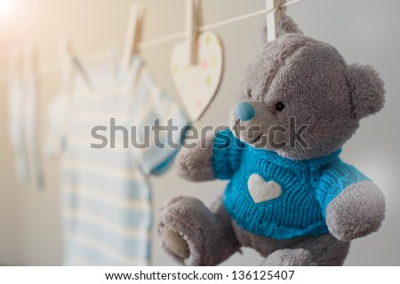 blue baby clothes on the clothesline - stock photo