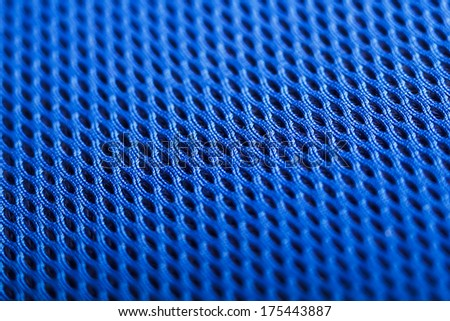 Blue background. Mesh fabric texture. Macro perspective - stock photo