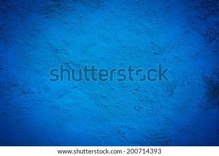 Blue background wall texture with dark edges - stock photo
