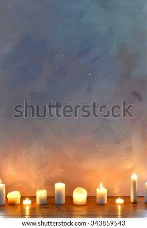 Blue background with candles - stock photo