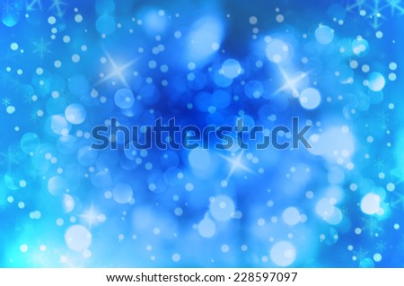 Blue background with real bokeh effect and snowflakes and snow - stock photo