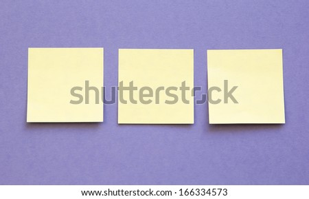 blue background with three blank sticky notes - stock photo
