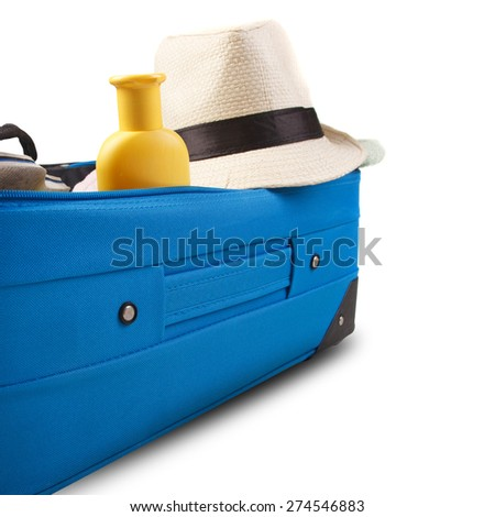 Blue bag with straw hat and towel,isolated on white background. - stock photo