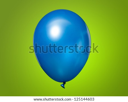Blue Balloon isolated on a green background - stock photo