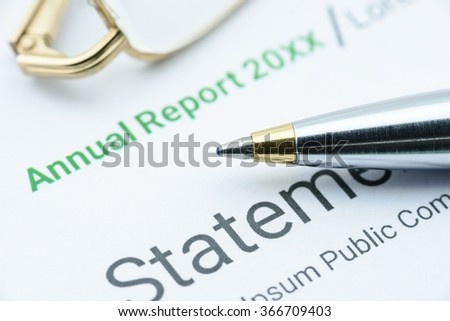 Blue ballpoint pen on an association's annual report waiting for a supervisor to supervise before submission to an Executive Committee to discuss in the meeting. Financial investment analysis concept. - stock photo