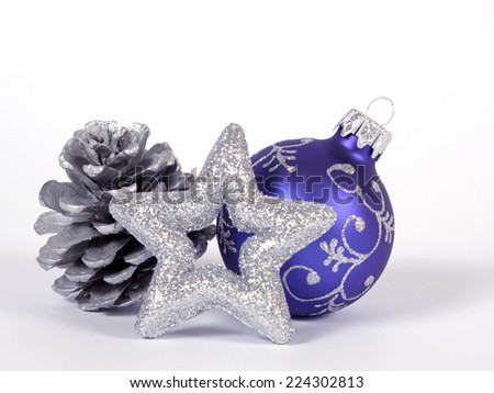 Blue bauble with the silver star - stock photo