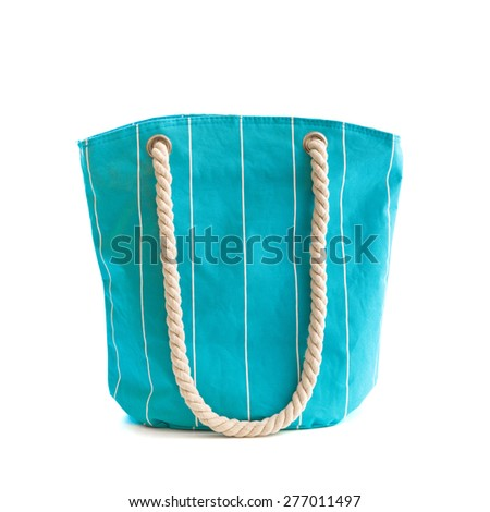 Blue beach bag isolated on white - stock photo