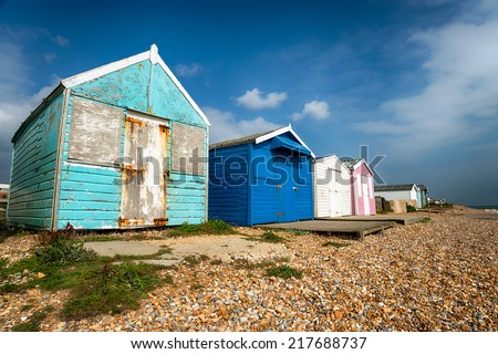 Blue beach huts at St Leonards on Sea in Hastings, East Sussex - stock photo