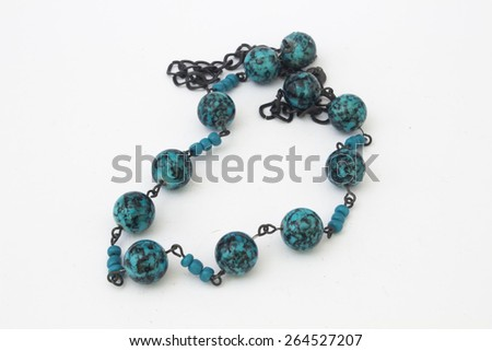 Blue beads on a white background. - stock photo