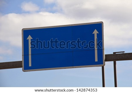 Blue blank highway sign - stock photo