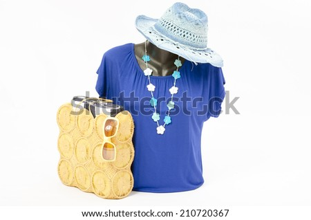 Blue blouse on mannequin with matching accessories. Elegant blouse on tailor's dummy with matching summer yellow purse, sunglasses, hat and necklace - stock photo