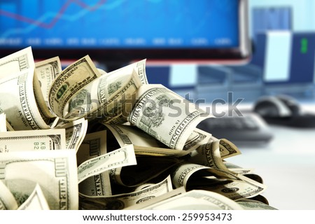 blue blurred background of computer and money of dollars  - stock photo