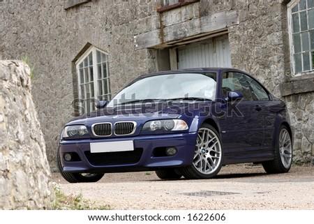 Blue BMW M3 CS with mansion Kent - stock photo