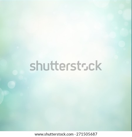 blue bokeh background with blurred shimmering white Christmas lights or abstract falling snow. Festive party background. Fantasy night or magical background glitter sparkles - stock photo