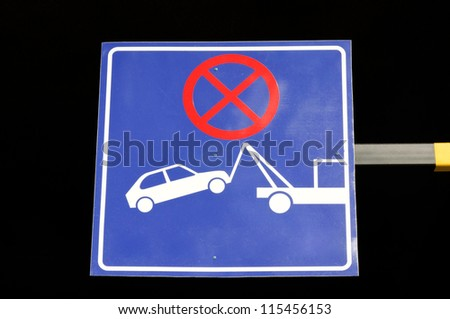 Blue bord with no parking sign - stock photo
