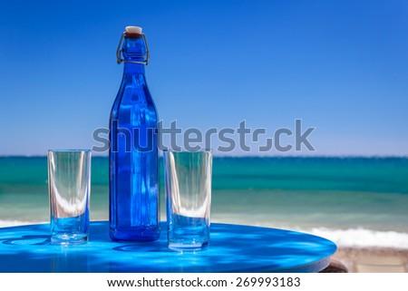 Blue bottle of water - stock photo