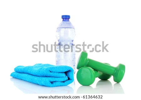 Blue bottle of water,  sports towel and exercise equipment isolated against a white background - stock photo