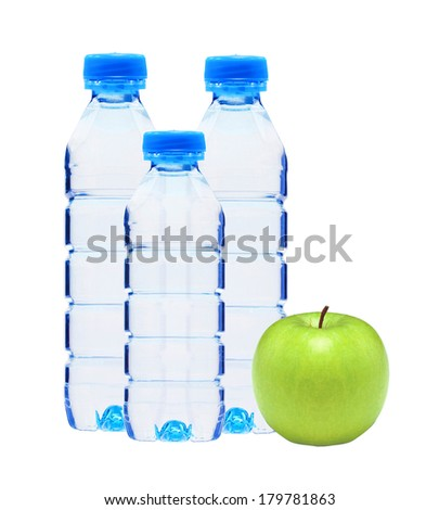 Blue bottles with water and green apple isolated on white background - stock photo