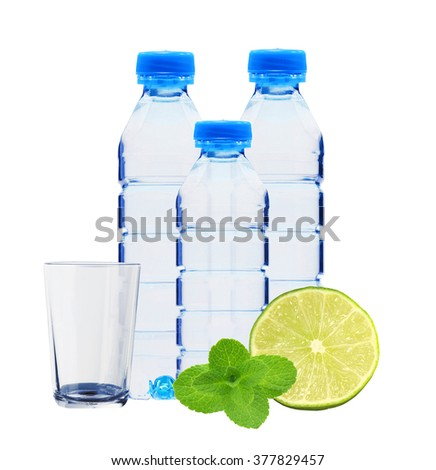 Blue bottles with water, mint herb and fresh green lime isolated on white background - stock photo