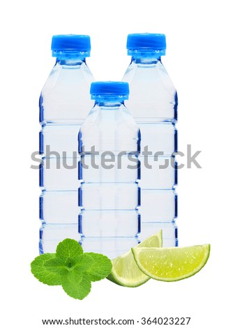 Blue bottles with water, mint herb and lime slices isolated on white background - stock photo