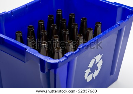 Blue box with recycle symbol and empty bottles - stock photo