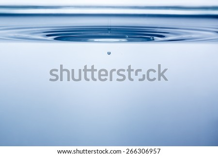 Blue bubbles after a splash in the water. Close-up. Under water - stock photo