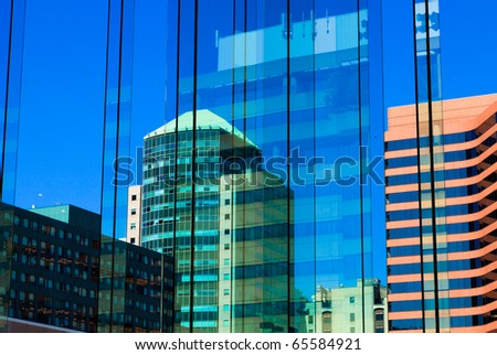 Blue buildings reflections - stock photo