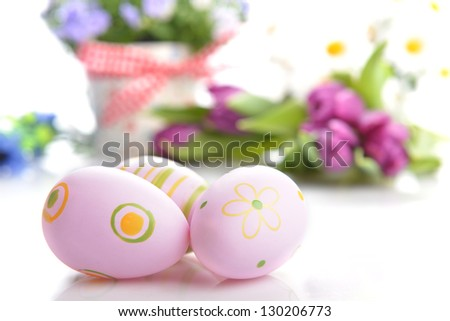blue campanula flowers in  flower pot and easter painted eggs - stock photo