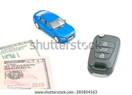 blue car, black car keys and dollar banknotes on white - stock photo