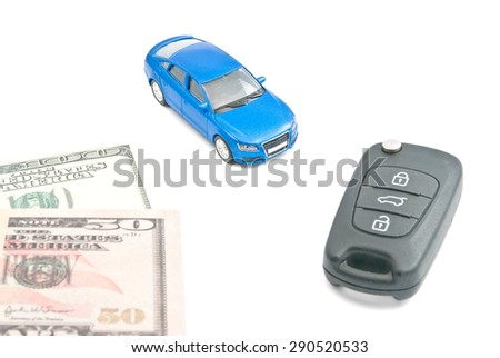 blue car, black car keys and dollar notes on white - stock photo