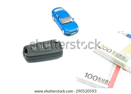blue car, black car keys and euro banknotes on white - stock photo