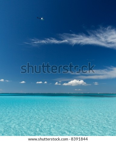 Blue caribbean water on a sand bank - stock photo