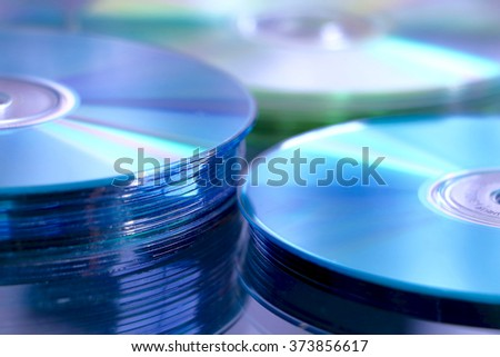 blue CD, DVD, Blue Ray stack - stock photo