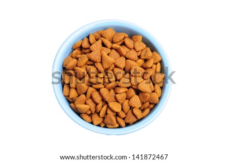 Blue ceramic dogs bowl. Dry dog food in bowl isolated on white background - stock photo