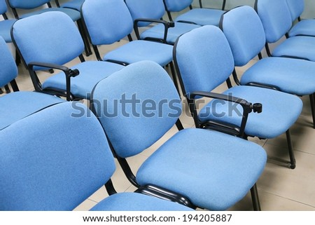 blue chairs in office meeting room - stock photo