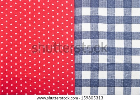 blue checked fabric on red polka dot fabric - stock photo