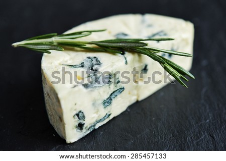 blue cheese and twig of rosemary.  - stock photo