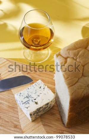 blue cheese, freshly baked bread and brandy bokals - stock photo