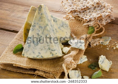 Blue cheese on a wooden table . Selective focus - stock photo