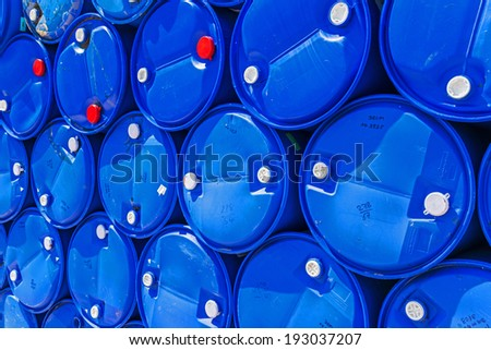 Blue chemical barrels stacked up. - stock photo