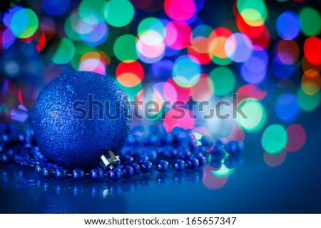 blue Christmas ball on a blue background - stock photo