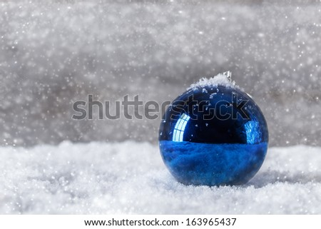 Blue christmas ball on snow - stock photo