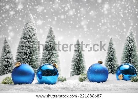 Blue Christmas balls and fir tree on snow - stock photo
